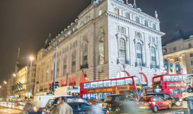 LONDON - OCTOBER 2013: Tourists walk in Piccadilly Circus, long. Exposure view. London attracts 30 million visitors annually Stock Photography