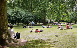 London office workers enjoying a sunny lunch break. Royalty Free Stock Images