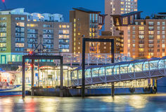 London old buildings near Canary Wharf at night. River reflectio Royalty Free Stock Image