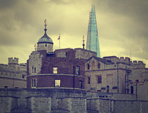 London old and new. Tower with Shard on skyline. Gloomy day. Stock Photos