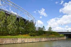 London Olympic Stadium and the River Lea. A view of the London Olympic Stadium and the City Mill River Stock Photo