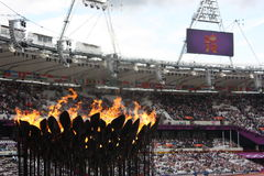 London 2012 Olympics cauldron. Flames burning in the cauldron of London 2012 Olympics during the games while the crowd is watching the events that took place on Stock Photos
