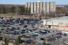 A full costco parking lot on a busy Saturday shopping day. London Ontario Canada, MArch 24 2018: A full parking lot on a Saturday in a Canadian Costco location Stock Images