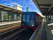 London Overground DLR. Red train blue stock photography
