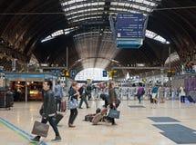 London, Paddington station. LONDON - September 14, 2013: Passengers in Paddington station. This central London railway station is terminus for Heathrow Express Royalty Free Stock Images