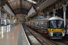 London Paddington train station. With Heathrow Express train on the platform Stock Image