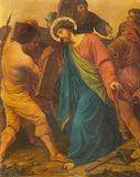 London - The painting Jesus is helped by Simon of Cyrene to carry his cross in church of St. James Spanish Place royalty free stock photo