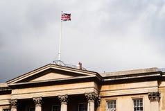 London palace with flag. Westminster, uk Stock Photos
