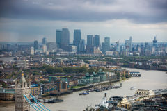 London panorama with River Thames, bridges and Canary Wharf banking and business district Stock Images