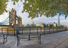 London - The panorama of Thames riverside, Tower bridge and Shard from promenade in morning light. London - The panorama of Thames rivere, Tower bridge and Shard Stock Photos