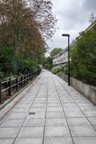 London park walkway. A footpath through a London park, grey skies since it's london Stock Image