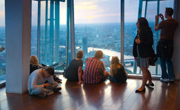 LONDON, People watching sunset from viewing London platform Stock Photography