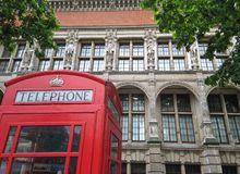London phone booth. Victoria and Albert Museum, with traditional phone booth Stock Photo