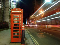 London phone booth. And street with light trails from a bus Stock Photos