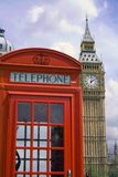 London phone booth/big ben. Traditional red London phone booth with Big Ben in the background, sunny day Royalty Free Stock Images