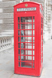London phone booth. Classic British red phone booth in London UK Stock Photo