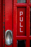 London phone booth detail. Detail of a traditional old fashioned red telephone booth, London, England, UK Royalty Free Stock Image