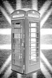 London phone booth, national flag Union Jack in background Stock Images