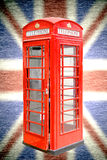 London phone booth, national flag Union Jack in background. For use website Stock Photography