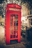 London Phone booth. Vintage tone red London telephone booth Stock Photos