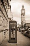 London phone box and Big Ben, sepia. London, UK Royalty Free Stock Images