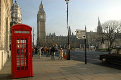 London phone box near Big Ben royalty free stock image