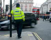 London Police Officer Leaning On Pelican Crossing. Shallow Depth of Field with Motion Effect Stock Photography