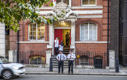 London Police Station. LONDON, ENGLAND - AUGUST 2012: Small office of borough police, Buckingham Gate, City of Westminster, London. Two police officers on the royalty free stock image