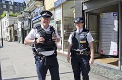 London Police. Two London bobbies walking the beat in the Kensington section of London, England Stock Images