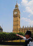 London policeman points the way. Royalty Free Stock Photo