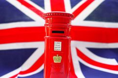 London post box on flag. Background Stock Image