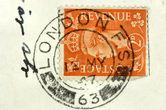 London post stamp. Vintage Great Britain post stamp cancelled in London royalty free stock image