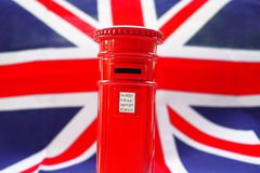 London postbox on flag UK. For background Royalty Free Stock Image