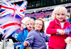 London prepares: Olympic test events. LONDON - MAY 6: Motion blurred children with the british flag at the London prepares series at the Olympic park in London Stock Image
