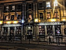 London Pub exterior in evening light royalty free stock images