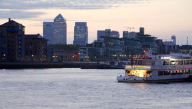 London - quay by daylight and skyscrapers in backg Royalty Free Stock Image