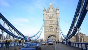 A London red bus crosses Tower Bridge stock footage