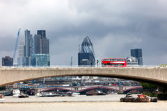 London Red Bus  Crossing The Thames. Stock Image