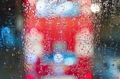 London red bus double-decker windows rain blur street lights night Royalty Free Stock Photo