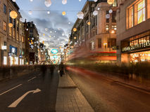 London red bus motion blur on Oxford Street, Christmas decoratio Royalty Free Stock Photography