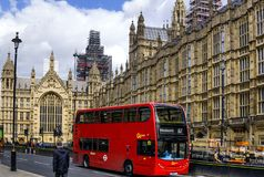 The London Red Bus in front of Westminster Houses of Parliament. royalty free stock photo