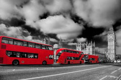 London with red buses against Big Ben in England, UK Royalty Free Stock Photography