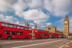 London with red buses against Big Ben in England, UK Stock Photos