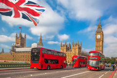 London with red buses against Big Ben in England, UK Stock Image