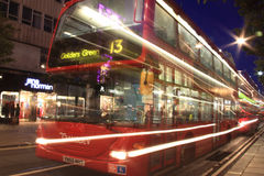 London  red double decker bus at night. London, UK – Oct 6, 2011: No 13 London  red double decker bus at night, passing in Oxford Street, on its journey across Royalty Free Stock Image