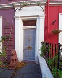 London, red and mauve vintage house front and lion statue. Notting hill London, red and mauve vintage house front and lion statue Royalty Free Stock Photo