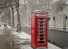 London Red Phone Booth. Iconic london Phone Booth on a snowy day Stock Photography