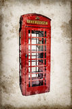 London red phone booth isolated on vintage sepia paper background Stock Images