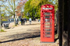 London red phone booth in a park stock images