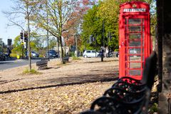 London red phone booth in a park stock photography